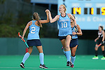 18 September 2015: North Carolina's Nina Notman (GER) (10) celebrates a goal with Lauren Moyer (2). The University of North Carolina Tar Heels hosted the University of Louisville Cardinals at Francis E. Henry Stadium in Chapel Hill, North Carolina in a 2015 NCAA Division I Field Hockey match. UNC won the game 5-0.