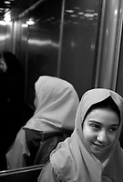 Teheran, Iran, October 2, 2007.Fatmeh, 6, leaves her home for school with her father.