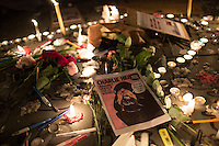 Pens, candles, and printouts left by demonstrators at Place de la Republique following the massacre at Charlie Hebdo in Paris where masked gunmen killed 12 people. Paris, France, (Jan. 7, 2015).
