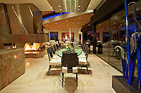 Fantastic open floorplan dining area is seen at night in ultra modern house.