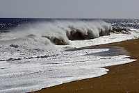 28 June 2005: Offshore wave crashes along a South facing beach at The Wedge in Newport Beach gets their first large swell of the summer. Body Surfers, Boogie Boarders, sponge riders, skim boarders and surfers caught waves in size from 10-20' feet today at this famous beach in Southern California. Water and Air temperature were 65' with a small offshore wind reaching over the Pacific Ocean.