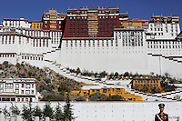 A paramilitary policeman stands guard in front of the Potala Palace in Lhasa, Tibet Autonomous Region, China November 17, 2015. The Potala Palace, once the seat of Tibetan government and traditional residence of Dalai Lama, is a 13-storey, 1000-room palace that is more than 1,300 years old and is more than 3,700 meters above sea level. It is a UNESCO World Heritage site. REUTERS/Damir Sagolj
