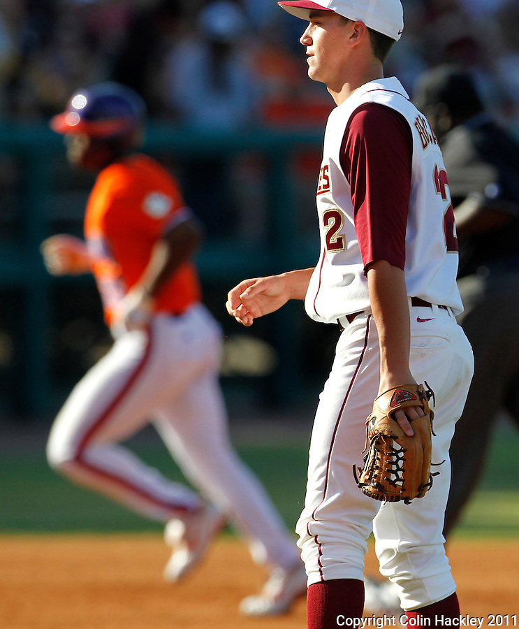 TALLAHASSEE, FL 5/20/11-FSU-CLEMBASE11 CH-Florida State pitcher Robert Benincasa reacts as Clemson's Chris Epps rounds the bases after hitting a second inning home run Friday at Dick Howser Stadium in Tallahassee. The Seminoles lost to the Tigers 4-7..COLIN HACKLEY PHOTO