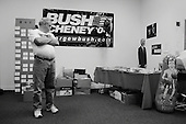 Cincinnati, Ohio.USA.October 25, 2004 ..Bush supporters arrive with a blow up Kerry punching doll that they immediately begin to hit.