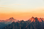 The setting sun sets the smoke from surrounding wildfires aglo in the vicinity of Golden Horn and Tower Mountain in the North Cascades of Washington State.