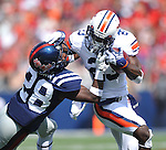 Auburn running back Onterio McCalebb (23) is tackled by Mississippi defensive back Mike Hilton (28) at Vaught-Hemingway Stadium in Oxford, Miss. on Saturday, October 13, 2012. (AP Photo/Oxford Eagle, Bruce Newman)..