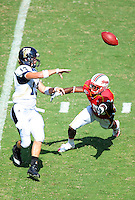 Panther's quarterback Jake Medlock gets off a pass with a Terrapin defender in his face. Maryland defeated FIU 42-28 during a game at Capital One Field at Byrd Stadium in College Park, MD on Saturday, September 25, 2010. Alan P. Santos/DC Sports Box