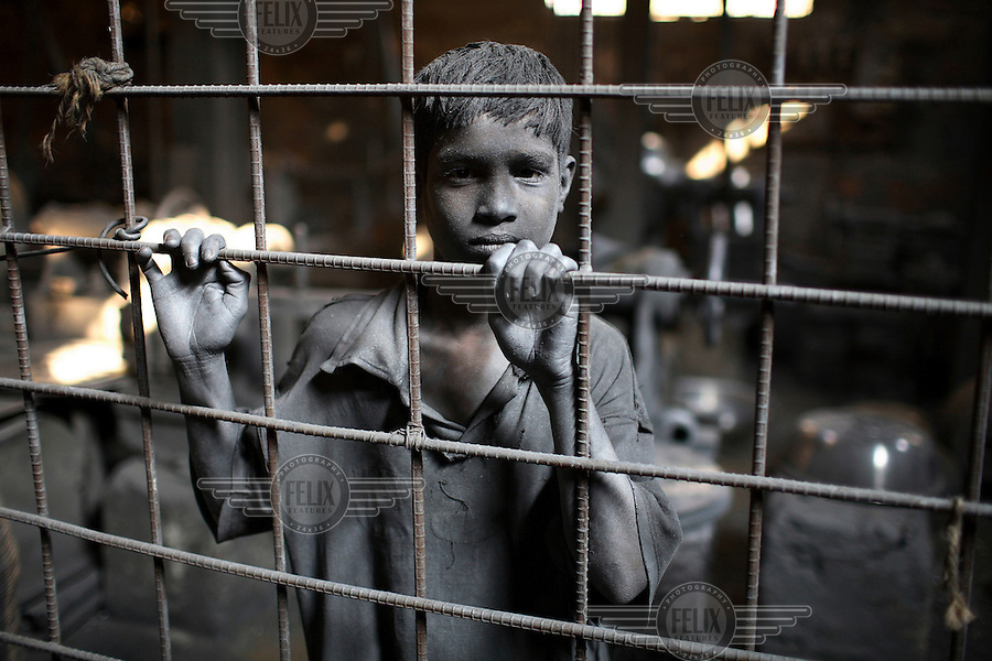 Child working in a silver cooking pot factory. It is common in Bangladesh for children of poor parents to work in various hazardous and labour-intensive workplaces to support their families. 17.5 percent of all children aged between 5-15 are engaged in economic activities. The average child labourer earns between 400 to 700 taka (1 USD = 70 taka) per month, while an adult worker earns up to 5,000 taka per month..