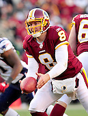 Washington Redskins quarterback Rex Grossman (8) pitches the ball to Roy Helu (not pictured) in fourth quarter action against the New England Patriots at FedEx Field in Landover, Maryland on Sunday December 11, 2011.  The Patriots won the game 34 - 27..Credit: Ron Sachs / CNP.(RESTRICTION: NO New York or New Jersey Newspapers or newspapers within a 75 mile radius of New York City)