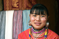 "Some women of the Karen hill tribe in Myanmar (Burma) and northern Thailand continue to practice an ancient custom called ""loaded ears."" The earlobes are elongated by large, heavy rings over many years. During the early stages the ear pieces are quite small, gradually stretching the ear lobe with larger and larger ear pieces."