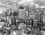 Pittsburgh PA:  Ariel view of the Pittsburgh skyline - 1960.  View includes he new Fort Pitt Bridge and Gateway 4 in Gateway Center under construction.