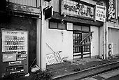 """Toyota City, Japan.June 14, 2009..Toyota City, the Detroit of Japan, and home of Toyota car manufacturing company...Closed shops near a Toyota company dorm building called """"Tanaka Wafu Ryou"""" have been empty for a few years."""