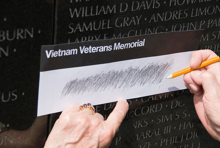 Washington DC; USA: The Vietnam Veterans Memorial on the Mall.  Doing a rubbing of a name..Photo copyright Lee Foster Photo # 8-washdc82981