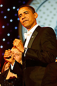 Washington, DC - January 20, 2009 -- United States President Barack Obama dances during the Neighborhood Inaugural Ball at the Washington Convention Center on January 20, 2009 in Washington, DC. Obama became the first African-American to be elected to the office of President in the history of the United States. .Credit: Chip Somodevilla - Pool via CNP