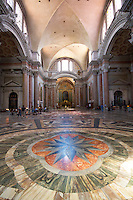 "The interior of this ancient basilica was once part of the biggest ""terme"" in ancient Rome - Terme di Diocleziano. It was transformed into the S. Maria degli Angeli and dei Martiri church in XVI century according to Michelangelo project. This ancient basilica is standing beside Piazza della Repubblica in Rome, Italy."