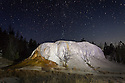 WY01900-00...WYOMING - Night time exposure of Orange Mound in the Upper Terraces Area of Mammoth Hot Springs of Yellowstone National Park.