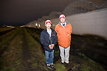 Mamoru Kikuchi (R) and Mitsuhiro Yahagi stand next to the greenhouses inside which they are producing tomatoes grown hydroponically in Sendai, Miyagi Prefecture, Japan on 30 Nov., 2011. .Photographer: Robert Gilhooly