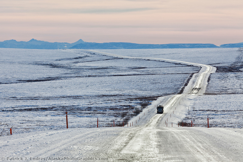 Trucker travels the icy James Dalton Highway, the Haul road, in winter conditions.