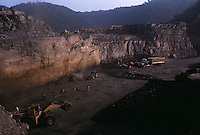 Small mountaintop removal site employes a small number of workers that are cleaning up what a large company left as rubble.
