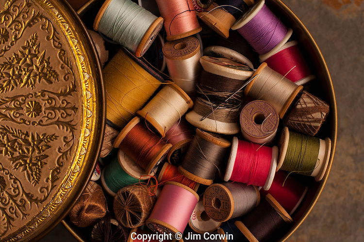 Multi colored thread in tin container