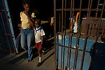 cuban mother with child exiting store