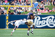 Annapolis, MD - SEPT 10, 2016: Navy Midshipmen wide receiver Jamir Tillman (4) beats cornerback Jhavon Williams (6) for a big gain during their match up at Navy-Marine Corps Memorial Stadium in Annapolis, MD. Navy held on to defeat Connecticut 28-24. (Photo by Phil Peters/Media Images International)