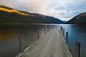 Wooden pier at Lake Rotoiti; sunset, New Zealand, South Island