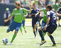 Seattle Sounders FC forward Roger Levesque passes the ball against New England Revolution defender AJ Soares during play between the Seattle Sounders FC and the New England Revolution at .CenturyLink Field in Seattle Sunday June 26, 2011. The Sounders won the game 2-1.   during play between the Seattle Sounders FC and the New England Revolution at .CenturyLink Field in Seattle Sunday June 26, 2011. The Sounders won the game 2-1.