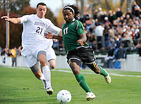 Lucky Mkosana (17) of the Dartmouth Big Green is chased by RJ Allen (21) of the Monmouth Hawks. Dartmouth defeated Monmouth 4-0 during the first round of the 2010 NCAA Division 1 Men's Soccer Championship on the Great Lawn of Monmouth University in West Long Branch, NJ, on November 18, 2010.
