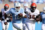 24 October 2015: UNC's Marquise Williams (12) is being chased by Virginia's Kwontie Moore (34). The University of North Carolina Tar Heels hosted the University of Virginia Cavaliers at Kenan Memorial Stadium in Chapel Hill, North Carolina in a 2015 NCAA Division I College Football game. UNC won the game 26-13.
