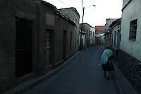 Walking to work on a cold morning in Potosi, Bolivia