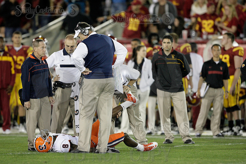 September 17, 2011:  Head Coach Doug Marrone looks over injured player #8 Keon Lyn on the field  during the NCAA College football game for the Big East Syracuse Orange visiting the Pac-12 USC Trojans for the first time since 1924 inside the Los Angeles Memorial Coliseum. Final Score was USC 38 Orange 17
