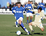 3 December 2006: UCSB's Tyler Rosenlund (left) dribbles away from the tackle of UCLA's Tony Beltran (9). California-Santa Barbara defeated California-Los Angeles 2-1 at Robert R. Hermann Stadium in St. Louis, Missouri in the NCAA men's college soccer tournament final game to win the 2006 NCAA Championship.