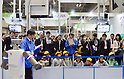 November 9th, 2011 : Tokyo, Japan &ndash; Visitors listen to the explanations. A newly invented robot performs during International Robot Exhibition 2011. This show is held to showcase new robots and high technology equipments at the Tokyo International Exhibit Center. International Robot Exhibition 2011 runs from November 9 &ndash; 12. (Photo by Yumeto Yamazaki/AFLO)