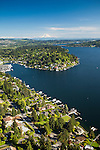 aerial photo of the Bellevue shoreline of Lake Washington with Mount Rainier in the background