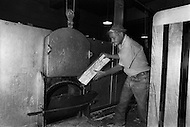 Oct 1971, Washington DC. An employee of the Bureau of Engraving and printing, burning rolls of badly printed post office stamps.