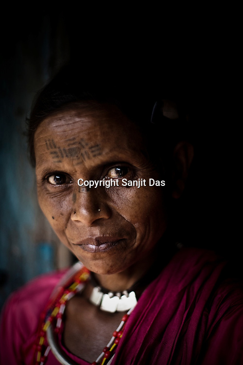 A maria tribes woman poses for a portrait inside her house in village Godhari in Chattisgarh, India. Photo: Sanjit Das
