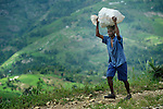 A man carries a bag home from the market n Les Palmes, a rural village in southern Haiti where the Lutheran World Federation has been working with survivors of the 2010 earthquake, along with other residents, to experience more abundant life.