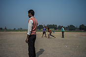Local villagers play cricket in the school grounds in Medawar Kalan in Ballia district of Uttar Pradesh, India. Photo: Sanjit Das/Panos for Der Spiegel