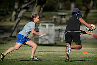 "Saturday, 01/17/09:  San Diego, California, USA:  Mandy Wilson (L) chases down another player during a game of touch rugby at Torrey Highlands Park in Del Mar.  An informal group of players meet every Saturday morning at 11am for games.  The sport of Touch Rugby is a fast paced, exciting version of the full contact game that is gaining popularity in San Diego.  As the name suggests, the ""touch"" version of it is not a full contact game but more like flag football.  Pick-up games can be found most Saturdays in the Del Mar Park and on Sundays at the beach in Del Mar or Mission Beach."