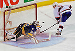 9 December 2006: Buffalo Sabres goalie Ryan Miller (30)  makes a save on Montreal Canadiens center Saku Koivu (11) of Finland in a shootout at the Bell Centre in Montreal, Canada. The Sabres defeated the Canadiens 3-2, winning their third contest in the month of December. Mandatory Photo credit: Ed Wolfstein Photo<br />  *** Editorial Sales through Icon Sports Media *** www.iconsportsmedia.com