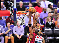Dwyane Wade of the Heat is fouled while going to the basket. goes up for a dunkWashington Wizards defeated the Miami Heat 105-101 at the Verizon Center in Washington, D.C. on Tuesday, December 4, 2012.   Alan P. Santos/DC Sports Box