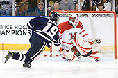 Mike Sislo (UNH - 19), Cody Reichard (Miami - 30) - The University of New Hampshire Wildcats defeated the Miami University RedHawks 3-1 (EN) in their NCAA Northeast Regional Semi-Final on Saturday, March 26, 2011, at Verizon Wireless Arena in Manchester, New Hampshire.
