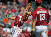 NWA Democrat-Gazette/JASON IVESTER<br /> Arkansas third baseman Chad Spanberger fields a fly ball Sunday, March 19, 2017, against Mississippi State at Baum Stadium in Fayetteville.