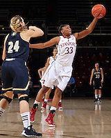 STANFORD, CA - December 22, 2014: Stanford Cardinal vs the UC Davis Aggies at Maples Pavilion.  Stanford defeated the Aggies 71-59. Amber Orrange (33) blocks a pass from Aggies' Brianna Salvatore (24)