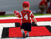 18 month old Brendan Brito of Salt Lake City plays in the endzone after University of Utah players participated in the annual Red and White spring football game at Rice-Eccles Stadium in Salt Lake City, Utah, Saturday, April 17, 2010. August Miller, Deseret News .