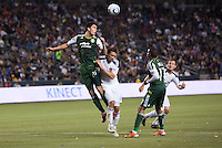Steve Purdy (25) of the Portland Timbers with a clearing ball, had his hands full all evening versus the LA Galaxy frontline. The LA Galaxy defeated the Portland Timbers 3-0 at Home Depot Center stadium in Carson, California on  April  23, 2011....