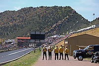 Jul. 21, 2013; Morrison, CO, USA: NHRA safety safari stands for the singing of the national anthem during the Mile High Nationals at Bandimere Speedway. Mandatory Credit: Mark J. Rebilas-