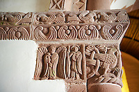 Norman Romanesque chancel arch capital of the church of St Peters, Rowlstone, Herefordshire, England. The relief sculptures are attributed to the Herefordshire School of stonemasons. The style draws upon Anglo-Saxon and celtic designs. The capital depicts a bird in decorative foliage, two angels one of which is holding a book.