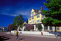 BICYCLE TRAFFIC AND THE WINDERMERE HOTEL ON MACKINAC ISLAND, MICHIGAN.